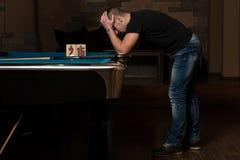 Sad Man lost His Billiard Game Stock Photo