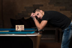 Sad Man lost His Billiard Game Stock Images