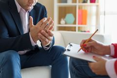 Man meeting counselor for marriage consultation royalty free stock photos