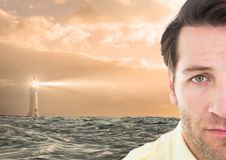 Sad man next to hopeful lighthouse. Digital composite of Sad man next to hopeful lighthouse Stock Image