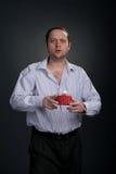 Sad man offering gifts Royalty Free Stock Image