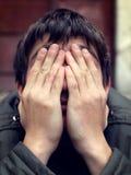 Sad Man outdoor. Sad Man with hidden Face closeup Royalty Free Stock Images