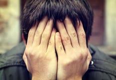 Sad Man outdoor. Toned Photo of Sad Man with hidden Face closeup Royalty Free Stock Photos