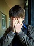 Sad Man outdoor. Sad Young Man close the Face on the Street Stock Photos