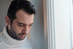 Sad man portrait looking out of the window Stock Photography
