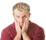 Sad Man Pulling on Face. Over white background Royalty Free Stock Image