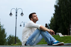 Sad man relax in summer city park Stock Photography