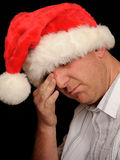 Sad man with Santa hat Royalty Free Stock Images