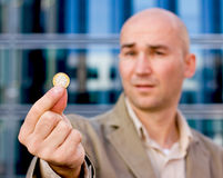 Sad man showin euro. Impoverished investment banker showing his last euro Stock Photos