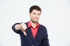 Sad man showing thumb down. Isolated on a white background Stock Images