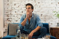 Sad Man Sitting at Cafe Think Hold Chin Looking Royalty Free Stock Image