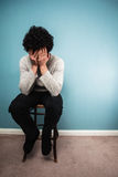 Sad man sitting on a chair Royalty Free Stock Images