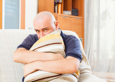 Sad man sitting on  couch Stock Photo
