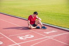 Sad man sitting and cry on the floor after losing. Sad asian man sitting and cry on the floor after losing in competition Royalty Free Stock Photo