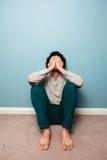 Sad man sitting on the floor Royalty Free Stock Image