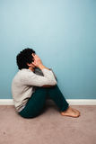 Sad man sitting on the floor Royalty Free Stock Images