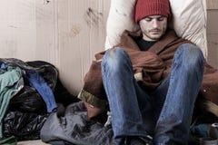 Sad man sitting on the street Royalty Free Stock Image