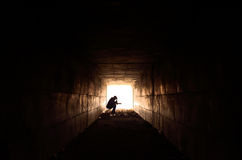 Sad man sitting in the tunnel Royalty Free Stock Photo