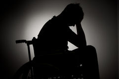 Sad man sitting on wheelchair Stock Images
