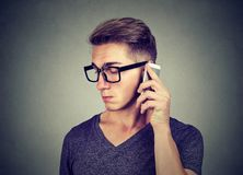 Sad man speaking on a phone royalty free stock images