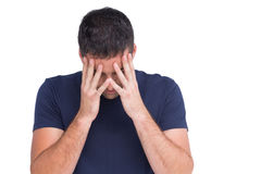 Sad man standing with his head in hands Stock Image