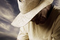 Sad man in a Straw Hat. Senior Man in a Straw Hat with his Head Down Royalty Free Stock Photos
