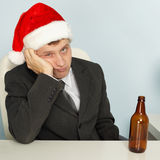 Sad Man Suffering From Hangover After Christmas Royalty Free Stock Photography