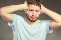 Sad man suffering from headache migraine pain. Royalty Free Stock Photography