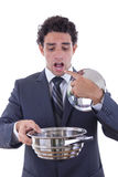 Sad man in suit holding cooking pot and asking for lunch Royalty Free Stock Images