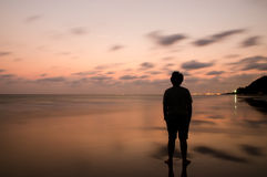 Sad man in the sunset time. On the beach stock photos