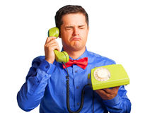 Sad man with telephone Royalty Free Stock Photos