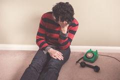 Sad man with telephone Stock Photo