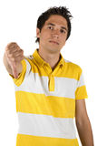 Sad man with thumb down. Sad young man showing thumb down isolated on white background,check also Teenage and friends Royalty Free Stock Photography