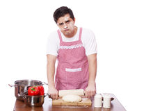 Sad man try to cooking Royalty Free Stock Images