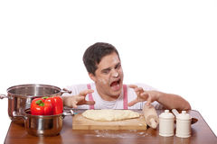 Sad man try to cooking. Royalty Free Stock Photo