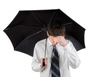 Sad Man with Umbrella. Sad Young Man with Umbrella Isolated on the White Background Royalty Free Stock Photo