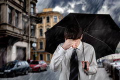 Sad Man under the Rain. Sad Young Man walking with Umbrella under the Rain in the City Stock Image