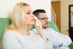 Sad man and unhappy woman at home Royalty Free Stock Images