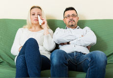 Sad man and unhappy woman at home Stock Photo
