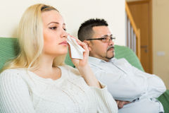 Sad man and unhappy woman at home Royalty Free Stock Photos