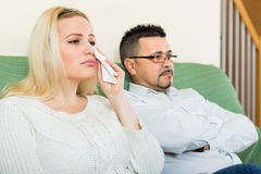 Sad man and unhappy woman at home Royalty Free Stock Image