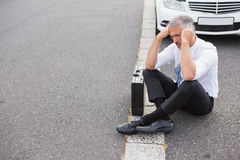 Sad man waiting for assistance after breaking down Stock Image