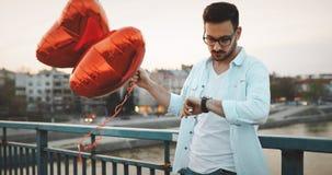Sad man waiting for date on valentine date. Sad unhappy man waiting for girlfriend on valentine date Stock Photo