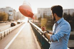 Sad man waiting for date on valentine date Royalty Free Stock Images