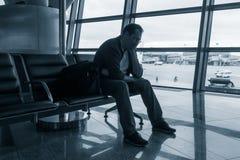 Sad man waiting for delayed flight Royalty Free Stock Photos