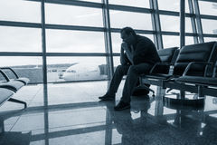 Sad man waiting for delayed flight Stock Image