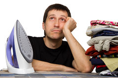 Sad man, wash clothing and iron Stock Photography