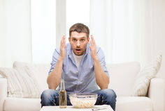 Sad man watching sports at home Royalty Free Stock Photo
