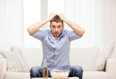 Sad man watching sports at home Royalty Free Stock Images