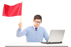 Sad man waving a red flag gesturing defeat. On white background stock photography